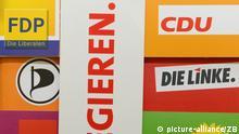 Schriften, Logos und Broschüren von deutschen politischen Parteien liegen am 09.01.2013 in Berlin zusammen mit dem SPD-Satz Ich will regieren. auf einem Tisch. Foto: Jens Kalaene/dpa