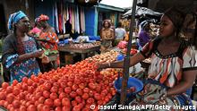 A woman sells tomatoes in the market of Abobo, a suburb of Abidjan on July 9, 2013 on the first day of the Muslim holy month of Ramadan in Ivory Coast. The holy month of Ramadan, during which Muslims fast from dawn to dusk, begins with the sighting of the new moon, which varies from country to country. AFP PHOTO / ISSOUF SANOGO (Photo credit should read ISSOUF SANOGO/AFP/Getty Images)