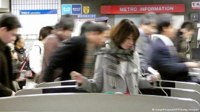 Japanese commuters walk through automated ticket gate of at a Tokyo subway station KARYN POUPEE/AFP/Getty Images