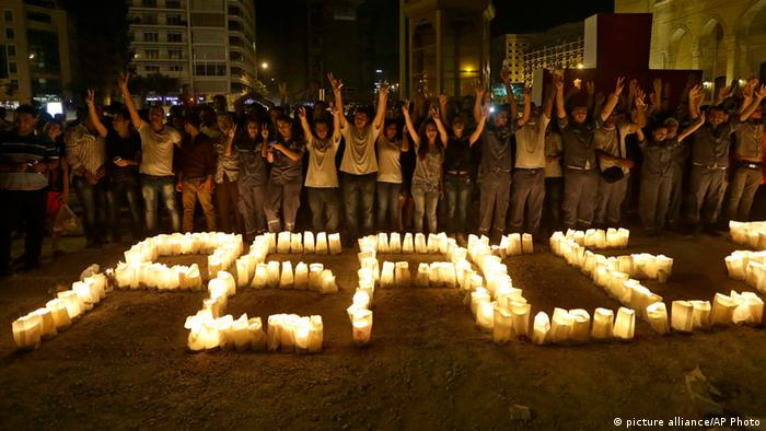 Lebanese women light candles during a vigil of Peace festival held by the Lebanese Red Cross in Downtown Beirut, Lebanon, Friday Aug. 23, 2013. Lebanon, a country that suffered its own 15-year civil war from 1975 to 1990, has an explosive sectarian mix of Sunni and Shiite Muslims, Christians and Palestinian refugees, as well as deep divisions between pro- and anti-Syrian factions.(AP Photo/Hussein Malla) pixel