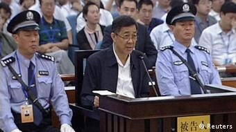 Ousted Chinese politician Bo Xilai speaks in court on the third day of his trial in Jinan, Shandong Province, in this still image taken from video shot on August 24, 2013. Bo Xilai accepted responsibility for 5 million yuan ($817,000) in funds he is accused of embezzling which ended up in his wife's bank account, saying he had let his attention wander, in testimony read out in court on Saturday. Bo, once a rising star in China's leadership, is facing charges of corruption, bribery and abuse of power. REUTERS/CCTV via Reuters TV (CHINA - Tags: POLITICS CRIME LAW IMAGES OF THE DAY) ATTENTION EDITORS � THIS IMAGE WAS PROVIDED BY A THIRD PARTY. NO SALES. NO ARCHIVES. FOR EDITORIAL USE ONLY. NOT FOR SALE FOR MARKETING OR ADVERTISING CAMPAIGNS. CHINA OUT. NO COMMERCIAL OR EDITORIAL SALES IN CHINA. THIS PICTURE IS DISTRIBUTED EXACTLY AS RECEIVED BY REUTERS, AS A SERVICE TO CLIENTS