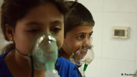 Two children treated with oxygen following a gas attack near Damascus