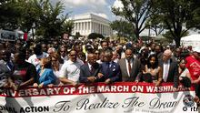 Rev. Al Sharpton links arms with Rep. John Lewis (D-GA), as they are joined by other civil rights activists and politicians to march during the 50th anniversary of the 1963 March on Washington for Jobs and Freedom at the Lincoln Memorial in Washington August 24, 2013.Thousands of marchers were expected in Washington, D.C. on Saturday to commemorate the 50th anniversary of the Rev. Martin Luther King Jr.'s I have a dream speech and to urge action on jobs, voting rights and gun violence. REUTERS/Kevin Lamarque (UNITED STATES - Tags: POLITICS ANNIVERSARY CIVIL UNREST)