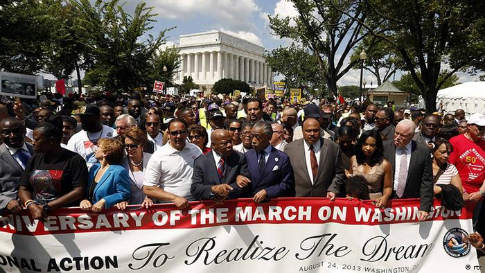 Rev. Al Sharpton links arms with Rep. John Lewis (D-GA), as they are joined by other civil rights activists and politicians to march during the 50th anniversary of the 1963 March on Washington for Jobs and Freedom at the Lincoln Memorial in Washington August 24, 2013. REUTERS/Kevin Lamarque (UNITED STATES - Tags: POLITICS ANNIVERSARY CIVIL UNREST)