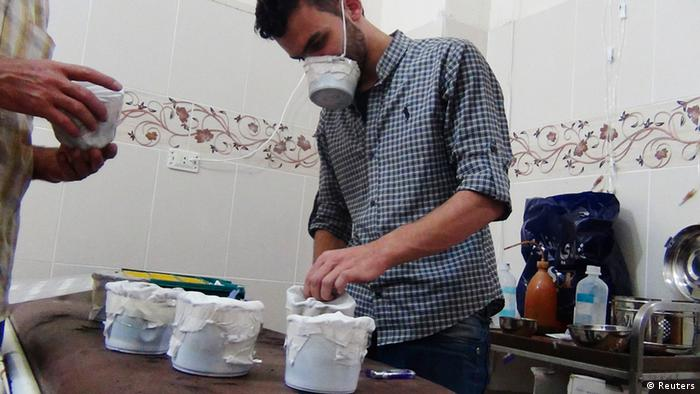 Activists and medics manufacture homemade chemical masks in Damascus' suburbs of Zamalka August 23, 2013. Picture taken August 23, 2013. REUTERS/Hadi Almonajed (SYRIA - Tags: HEALTH CONFLICT CIVIL UNREST POLITICS)