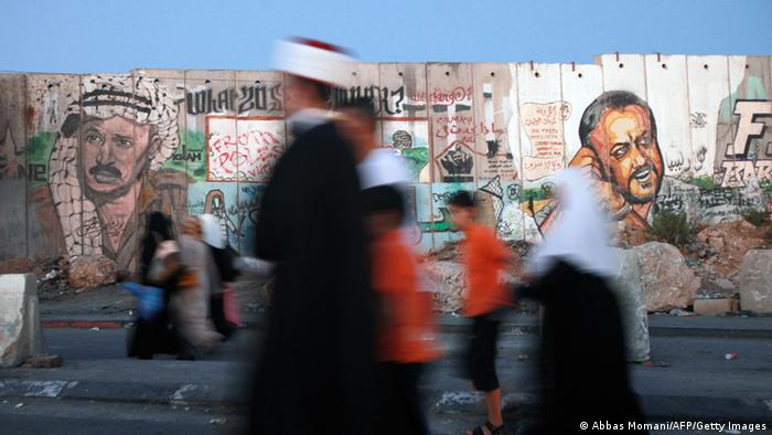 Palestinian Muslim worshipers walk towards the Qalandia checkpoint between Ramallah and Jerusalem, in the occupied West Bank, on the last Friday of the holy month of Ramadan on August 2, 2013, as they head to the al-Aqsa mosque compound in Jerusalem's Old City to pray. Muslims fasting in the month of Ramadan must abstain from food, drink and sex from dawn to dusk, when they break the fast with a meal known as Iftar. AFP PHOTO/ABBAS MOMANI (Photo credit should read ABBAS MOMANI/AFP/Getty Images)
