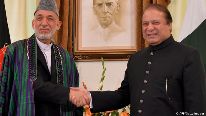 Pakistani Prime Minister Nawaz Sharif (R) shakes hands with Afghan President Hamid Karzai at The Prime Ministers House in Islamabad on August 26, 2013. (Photo credit AAMIR QURESHI/AFP/Getty Images)