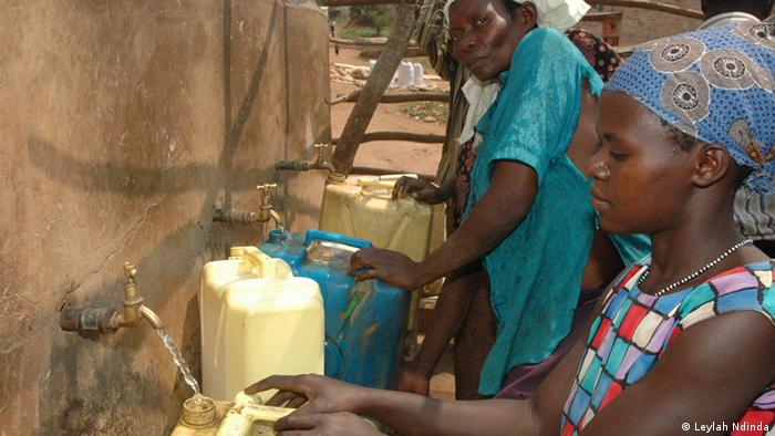 A woman collects water in Uganda.