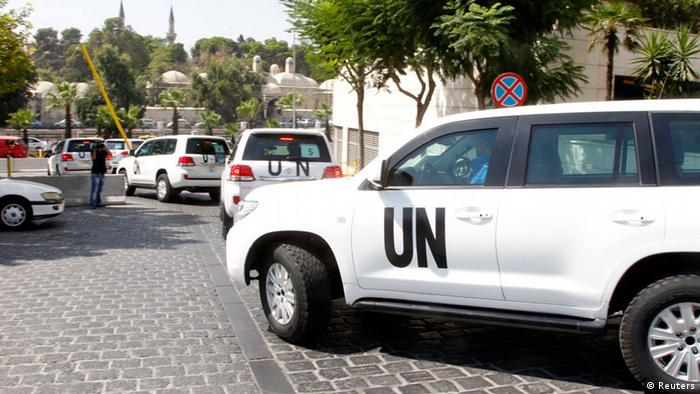 United Nations vehicles transport a team of chemical weapons experts to the scene of a poison gas attack outside the Syrian capital of Damascus. Photo: Reuters/Khaled al-Hariri.