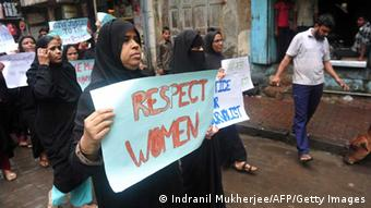 Indian Muslim women hold posters during a protest march against the gang-rape of a female photographer in Mumbai on August 26, 2013. Mumbai police arrested the fifth and final member of a gang suspected of raping a photographer, a crime that reignited anger about women's safety in India following a similar attack last year. The latest arrest came as the victim's family urged the nation, including the media, to continue to fight for justice 'for all those victims and their families' who have gone through 'the same hell as we have'. AFP PHOTO/Indranil MUKHERJEE (Photo credit should read INDRANIL MUKHERJEE/AFP/Getty Images)