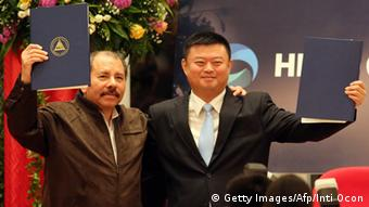 Nicaraguan President Daniel Ortega (L) stands with Wang Jing, president of of the Chinese company HK Nicaragua Development Gran Canal Interoceanico, during the framework agreement for the construction of the Interoceanic Grand Canal in Managua, on June 14, 2013. (Photo: Inti Ocon/AFP/Getty Images)