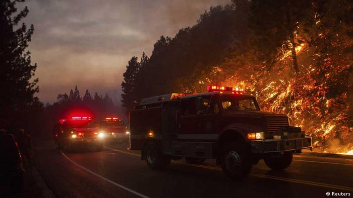 Fire trucks drive along Highway 120 while fighting the Rim Fire near Buck Meadows, California, August 24, 2013. REUTERS/Max Whittaker