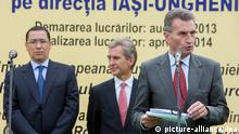 epa03838881 The Prime Minister of Romania Victor Ponta (L) with his Moldovan counterpart Iurie Leanca (C) listen to Gunther Oettinger, the European Comissar for energy (R) talking at the opening ceremony of the construction of the Iashi-Ungheni Moldo-Romanian pipeline at Zagarancea village in Ungheni district, Moldova, 27 August 2013. EPA/DUMITRU DORU