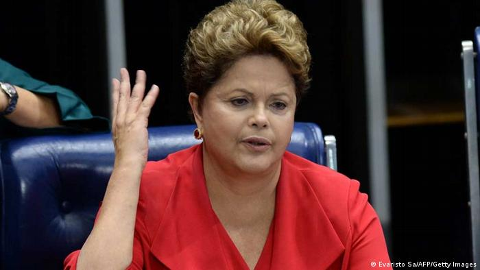 Brazilian President Dilma Rousseff participates in the formal session of the senate during which the report of the inquiry commission that investigated the violence against women in the country is presented, in Brasilia on August 27, 2013. AFP PHOTO / Evaristo SA (Photo credit should read EVARISTO SA/AFP/Getty Images)