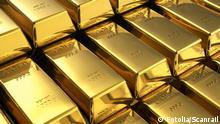Gambar ilustrasi tumpukan emas batangan