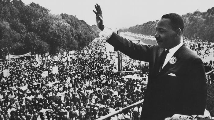Martin Luther King Jr waves to a crowd at the Lincoln Memorial in Washington DC