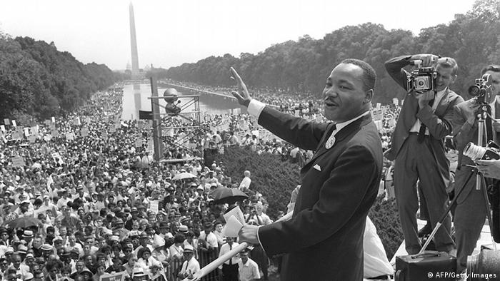 WASHINGTON, UNITED STATES: The civil rights leader Martin Luther KIng (C) waves to supporters 28 August 1963 on the Mall in Washington DC (Washington Monument in background) during the 'March on Washington'. King said the march was 'the greatest demonstration of freedom in the history of the United States.' Martin Luther King was assassinated on 04 April 1968 in Memphis, Tennessee. James Earl Ray confessed to shooting King and was sentenced to 99 years in prison. King's killing sent shock waves through American society at the time, and is still regarded as a landmark event in recent US history. (Photo credit should read AFP/AFP/Getty Images)