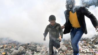 A Syrian man escorts a boy PHOTO/BULENT KILIC/AFP/Getty Images)