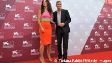 US actor George Clooney and US actress Sandra Bullock pose during the photocall of the movie 'Gravity' presented out of competition on the opening day of the 70th Venice Film Festival on August 28, 2013 at Venice Lido. The Venice film festival kicks off today with the arrival of movie stars on water taxis for a dark line-up flush with fiendish tales of abuse, betrayal and survival. The world's oldest film festival opens with 'Gravity', a 3-D sci-fi thriller starring George Clooney and Sandra Bullock as astronauts who are flung into deep space when a debris shower destroys their shuttle. AFP PHOTO / TIZIANA FABI (Photo credit should read TIZIANA FABI/AFP/Getty Images)