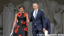 WASHINGTON, DC - AUGUST 28: U.S. President Barack Obama (R) and first lady Michelle Obama arrive at the Let Freedom Ring ceremony at the Lincoln Memorial August 28, 2013 in Washington, DC. The event was to commemorate the 50th anniversary of Dr. Martin Luther King Jr.'s I Have a Dream speech and the March on Washington for Jobs and Freedom. (Photo by Alex Wong/Getty Images)