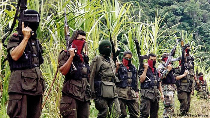 BOGOTA, COLOMBIA: Members of the Colombian National Liberation Army(ELN) guerrilla group stand in the mountains of Perija near the border town of Cucuta 06 December 1999 during a meeting with reporters. The Colombian government has begun a track of talks with the ELN, Colombia's second largest leftists rebel group but has not bowed to their demands for a demilitarized zone in the northern Colombia. AFP PHOTO (Photo credit should read STR/AFP/Getty Images)