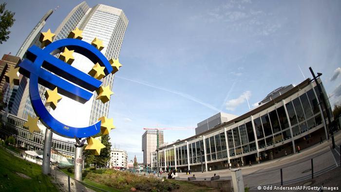 The Euro sign is seen outside the ECB headquarter in Frankfurt AFP PHOTO / ODD ANDERSEN