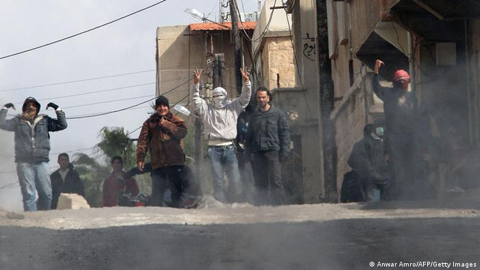 Anti-government protesters gesture on the streets of Daraa, March 23, 2011. (Photo: ANWAR AMRO/AFP/Getty Images)