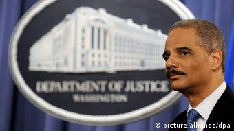 U.S. Attorney General Eric H. Holder stands in front of a U.S. Department of Justice backdrop during a press conference at the Department of Justice in Washington, DC, USA, 25 February 2009. Holder announced the arrest of more than 750 individuals on narcotics-related charges and the seizure of more than 23 tons of narcotics as part of a 21-month multi-agency law enforcement investigation known as 'Operation Xcellerator'. The operation targeted the Sinaloa Cartel, a major Mexican drug trafficking organisation. EPA/MICHAEL REYNOLDS +++(c) dpa - Report+++
