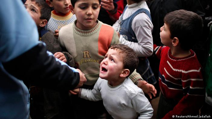 A Syrian child refugee cries as he stands at a queue waiting to receive aid from Turkish humanitarian agencies at Bab al-Salam refugee camp in Syria near the Turkish border in this December 22, 2012 file photograph. The civil war that has unfolded in Syria over the past two and a half years has killed more than 100,000 people and driven millions from their homes. Now, in the wake of last week's chemical weapons attack near Damascus, the world is waiting to see what action Western powers will take and what impact this will have on the Middle Eastern nation and the rest of the volatile region. REUTERS/Ahmed Jadallah/Files (SYRIA - Tags: CIVIL UNREST POLITICS CONFLICT) ATTENTION EDITORS: PICTURE 24 OF 40 FOR PACKAGE 'SYRIA - A DESCENT INTO CHAOS.' SEARCH 'SYRIA TIMELINE' FOR ALL IMAGES