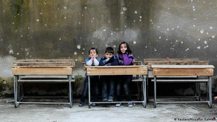 Children sit on school benches at Al-Tawheed school in Aleppo in this January 1, 2013 file photograph. The civil war that has unfolded in Syria over the past two and a half years has killed more than 100,000 people and driven millions from their homes. Now, in the wake of last week's chemical weapons attack near Damascus, the world is waiting to see what action Western powers will take and what impact this will have on the Middle Eastern nation and the rest of the volatile region. REUTERS/Muzaffar Salman/Files (SYRIA - Tags: EDUCATION SOCIETY) ATTENTION EDITORS: PICTURE 25 OF 40 FOR PACKAGE 'SYRIA - A DESCENT INTO CHAOS.' SEARCH 'SYRIA TIMELINE' FOR ALL IMAGES