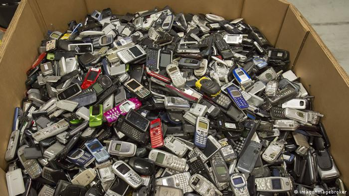 A box of old cell phones