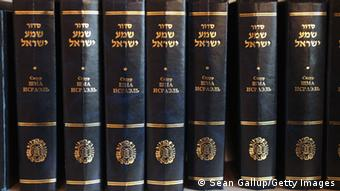 OLDENBURG, GERMANY - MARCH 31: Jewish prayer books in Russian and Hebrew line a shelf in the small synagogue on March 31, 2011 in Oldenburg, Germany. Oldenburg is now home to Rabbi Alina Treiger, who is Germany's first female rabbi to be ordained in Germany since World War II. Originally from Ukraine, she completed her rabbinical studies at the Abraham Geiger Kolleg in Potsdam and was ordained in Berlin in 2010. She has since taken up her duties to serve the Jewish communities in Oldenburg and Delmenhorst, which are comprised mostly of Russian-speaking Jews from the former Soviet Union that came to Germany after 1989. (Photo by Sean Gallup/Getty Images)