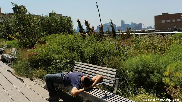 A man relaxes on a bench in the along the High Line Park in Manhattan (Photo: Spencer Platt/Getty Images)
