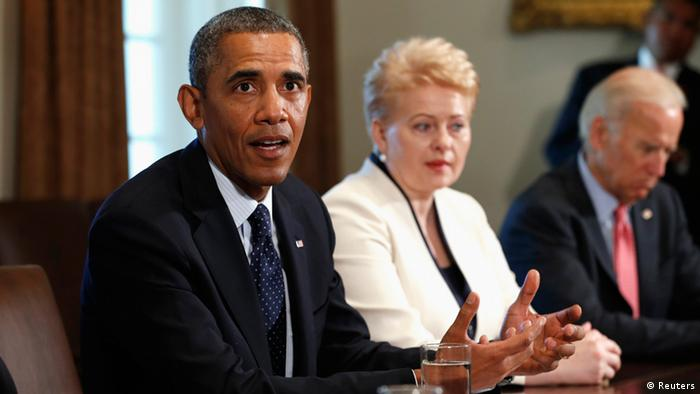 U.S. President Barack Obama pauses while speaking about Syria to reporters during a meeting with Baltic leaders in the Cabinet Room of the White House in Washington August 30, 2013. Seated with Obama are Lithuania's President Dalia Grybauskaite (C) and Vice President Joe Biden (R). REUTERS/Kevin Lamarque (UNITED STATES - Tags: POLITICS)