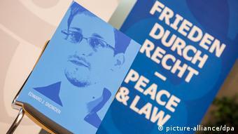 Edward Snowden's photo on a poster at the award event Photo: Florian Schuh/dpa +++(c) dpa - Bildfunk+++