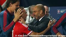 GettyImages 178675482 PRAGUE, CZECH REPUBLIC - AUGUST 30: Franck Ribery (C) of Bayern Muenchen celebrates scoring his first goal with his head coach Pep Guardiola and team mate Daniel Van Buyten (L) during the UEFA Super Cup between FC Bayern Muenchen and Chelsea FC at Stadion Eden on August 30, 2013 in Prague, Czech Republic. (Photo by Alexander Hassenstein/Bongarts/Getty Images)