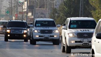 A UN convoy of vehicles, carrying inspectors investigating allegations of the Syrian regime's use of chemical weapons, drives through the Lebanese village of Taanayel after crossing into Lebanon from Syria on August 31, 2013. (Photo ANWAR AMRO/AFP/Getty Images)