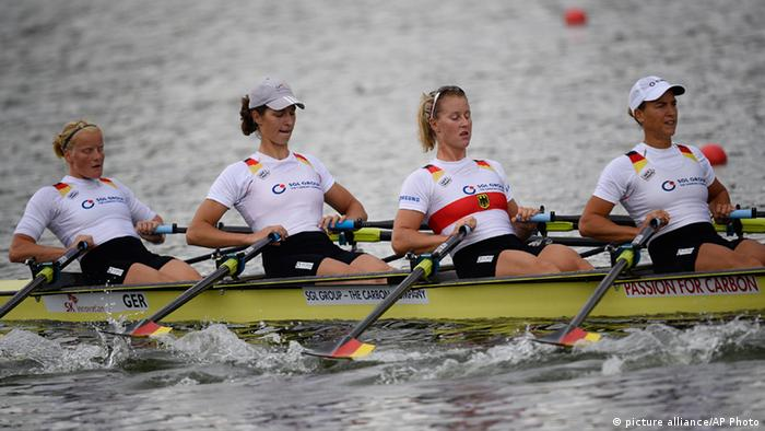 Germany's quadruple sculls team members, from right, Britta Oppelt, Julia Richter, Carina Baer and Annekatrin Thiele (AP Photo/Lee Jin-man)