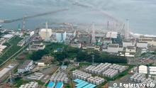 An aerial view shows Tokyo Electric Power Co. (TEPCO)'s tsunami-crippled Fukushima Daiichi nuclear power plant and its contaminated water storage tanks (bottom) in Fukushima, in this August 20, 2013 file photo taken by Kyodo. Radiation near a tank holding highly contaminated water at Japan's crippled Fukushima nuclear plant has spiked 18-fold, the plant's operator said on September 1, 2013, highlighting the struggle to bring the crisis under control after more than two years. To match Story JAPAN-FUKUSHIMA/ Mandatory Credit. REUTERS/Kyodo/Files (JAPAN - Tags: DISASTER ENVIRONMENT POLITICS ENERGY BUSINESS) ATTENTION EDITORS - THIS IMAGE WAS PROVIDED BY A THIRD PARTY. FOR EDITORIAL USE ONLY. NOT FOR SALE FOR MARKETING OR ADVERTISING CAMPAIGNS. THIS PICTURE IS DISTRIBUTED EXACTLY AS RECEIVED BY REUTERS, AS A SERVICE TO CLIENTS. MANDATORY CREDIT. JAPAN OUT. NO COMMERCIAL OR EDITORIAL SALES IN JAPAN. YES
