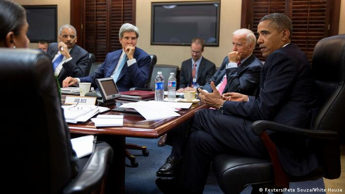 U.S. President Barack Obama (R) meets with his national security staff to discuss the situation in Syria in the Situation Room of the White House in Washington, in this photo taken August 30, 2013, courtesy of the White House. Others in the picture include (from L-R) National Security Advisor Susan Rice, Attorney General Eric Holder, Secretary of State John Kerry and Vice President Joe Biden. Obama's top advisers were to make their case for limited military strikes against Syria to the full Senate on Saturday, presenting evidence of a chemical weapons attack last week that the White House says killed more than 1,400 people. Picture taken August 30, 2013. REUTERS/Pete Souza/White House/Handout via Reuters (UNITED STATES - Tags: POLITICS CONFLICT TPX IMAGES OF THE DAY) ATTENTION EDITORS - THIS IMAGE WAS PROVIDED BY A THIRD PARTY. FOR EDITORIAL USE ONLY. NOT FOR SALE FOR MARKETING OR ADVERTISING CAMPAIGNS. THIS PICTURE IS DISTRIBUTED EXACTLY AS RECEIVED BY REUTERS, AS A SERVICE TO CLIENTS