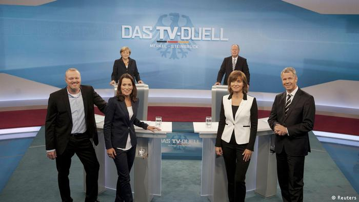 German Chancellor Angela Merkel and her challenger, the top candidate in the upcoming German general elections of the Social Democratic Party (SPD), Peer Steinbrueck, pose with TV hosts during their TV duel in Berlin, September 1, 2013. German voters will take to the polls in a general election on September 22. The hosts pictured are (from left): Stefan Raab (ProSieben), Anne Will (ARD), Maybrit Illner and Peter Kloeppel (RTL). REUTERS/ARD/Max Kohr/Pool (GERMANY - Tags: POLITICS ELECTIONS) FOR EDITORIAL USE ONLY. NOT FOR SALE FOR MARKETING OR ADVERTISING CAMPAIGNS. MANDATORY CREDIT. ATTENTION EDITORS: PICTURE TO BE USED ONLY IN RELATION TO THE TV DEBATE