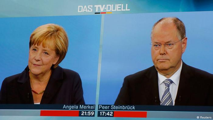 A TV duel of German Chancellor Angela Merkel of the Christian Democratic Union (CDU) with her challenger, the top candidate of the Social Democratic Party (SPD) in the upcoming German general elections Peer Steinbrueck, is shown on a screen in Berlin, September 1, 2013. German voters will take to the polls in a general election on September 22. REUTERS/Fabrizio Bensch (GERMANY - Tags: POLITICS ELECTIONS)