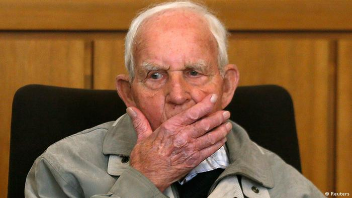 Siert Bruins, a suspected Nazi war criminal, gestures before the start of his trial in the western German city of Hagen September 2, 2013. A 92-year-old who served in the Waffen-SS, Adolf Hitler's elite Nazi troops, went on trial on Monday on charges of having shot in the back and killed a Dutch resistance fighter at the end of World War Two. In an televised interview with broadcaster Das Erste, Bruins says he was present at the murder of Aldert Klaas Dijkema but says another soldier, now dead, shot him. The Hagen court already sentenced the Dutch-born accused, who acquired German citizenship while serving as a German security and border guard in the Netherlands during World War Two, to seven years in jail in 1980 for being accessory to the murder of two Jewish brothers in April 1945. REUTERS/Wolfgang Rattay (GERMANY - Tags: POLITICS CRIME LAW HEADSHOT)