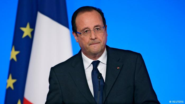 France's President Francois Hollande reacts as he delivers a speech during the annual Conference of Ambassadors at the Elysee Palace in Paris August 27, 2013. President Hollande said on Tuesday that France stood ready to punish the perpetrators of a chemical attack in Damascus last week and would increase its military support to the Syrian opposition. REUTERS/Kenzo Tribouillard/Pool (FRANCE - Tags: POLITICS)