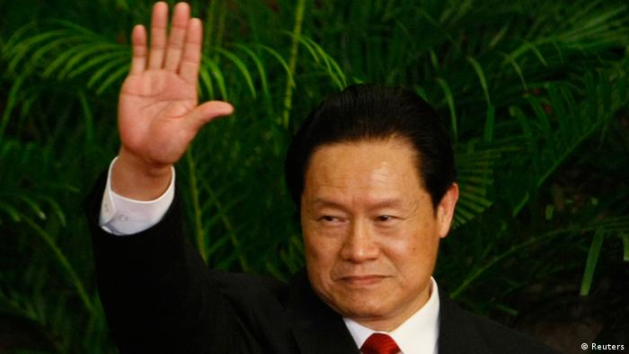 Then China's Politburo Standing Committee Member Zhou Yongkang waves during a meeting with the media at the Great Hall of the People in Beijing October 22, 2007. Few figures are as divisive in China as former domestic security tsar Zhou, reportedly under investigation by the ruling Communist Party for corruption. Even the once ambitious but now ousted politician Bo Xilai, whose trial on corruption ended on August 26, 2013, doesn't evoke the same depth of feeling that Zhou does. From the oil fields of frigid northeastern China, the hulking Zhou worked his way up to the elite Politburo Standing Committee, where his spending on domestic security exceeded the separate budgets for defence, healthcare or education. Picture taken October 22, 2007. To match story CHINA-POLITICS/ZHOU REUTERS/Jason Lee (CHINA - Tags: CRIME LAW POLITICS)