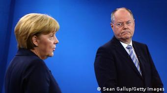 BERLIN, GERMANY - SEPTEMBER 01: In this screenshot taken from German television German Chancellor and Christian Democrat (CDU) Angela Merkel and Social Democrats (SPD) chancellor candidate Peer Steinbrueck debate live at the Adlershof studios on September 1, 2013 in Berlin, Germany. Today's live debate is the only one between the two candidates ahead of German elections scheduled for September 22. (Photo by Sean Gallup/Getty Images)