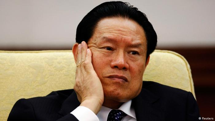 Then China's Public Security Minister Zhou Yongkang reacts as he attends the Hebei delegation discussion sessions at the 17th National Congress of the Communist Party of China at the Great Hall of the People, in Beijing October 16, 2007. Few figures are as divisive in China as former domestic security tsar Zhou, reportedly under investigation by the ruling Communist Party for corruption. Even the once ambitious but now ousted politician Bo Xilai, whose trial on corruption ended on August 26, 2013, doesn't evoke the same depth of feeling that Zhou does. From the oil fields of frigid northeastern China, the hulking Zhou worked his way up to the elite Politburo Standing Committee, where his spending on domestic security exceeded the separate budgets for defence, healthcare or education. Picture taken October 16, 2007. To match story CHINA-POLITICS/ZHOU REUTERS/Jason Lee (CHINA - Tags: POLITICS CRIME LAW)