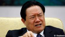 China's Public Security Minister Zhou Yongkang gestures as he attends a discussion session of the 17th National Congress of the Communist Party of China in Beijing in this October 16, 2007 file photograph. To match CHINA-POLITICS/BO-CRONIES REUTERS/Jason Lee/Files (CHINA - Tags: POLITICS HEADSHOT)