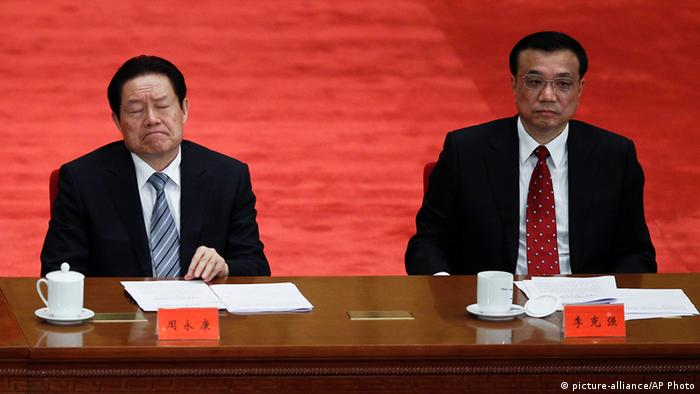 Zhou Yongkang, left, then Chinese Communist Party Politburo Standing Committee member in charge of security, and Li Keqiang, right, then Chinese vice premier and now premier, attend a conference to celebrate the 90th anniversary of the founding of Chinese Communist Youth League at the Great Hall of the People in Beijing. An influential Hong Kong newspaper reported Friday, Aug. 30, 2013. (Photo: AP Photo/Alexander F. Yuan, File)