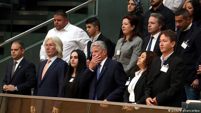 German Federal President Joachim Gauck (seated third from right in the Bundestag gallery alongide relatives of victims) listens to the Bundestag debate on 2.09.2013 on the parliamentary inquiry committee's report on the NSU terror cell. Photo: Wolfgang Kumm/dpa
